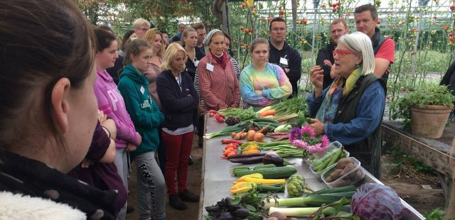 Darina in the glasshouse with students